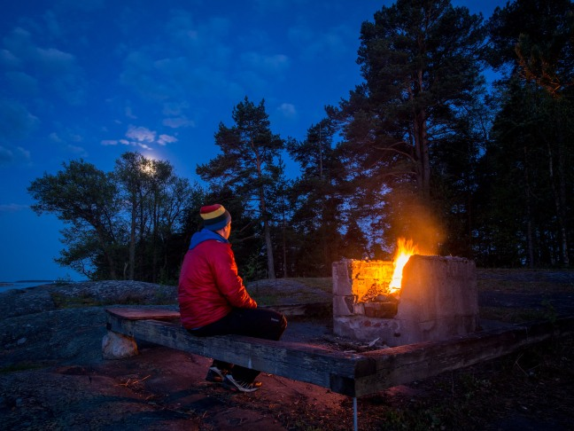 Enjoying the fire at Pihlajaluoto, Helsinki.