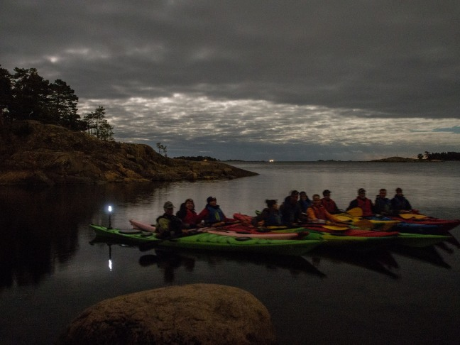 Group of kayakers at night in Eastern Helsinki