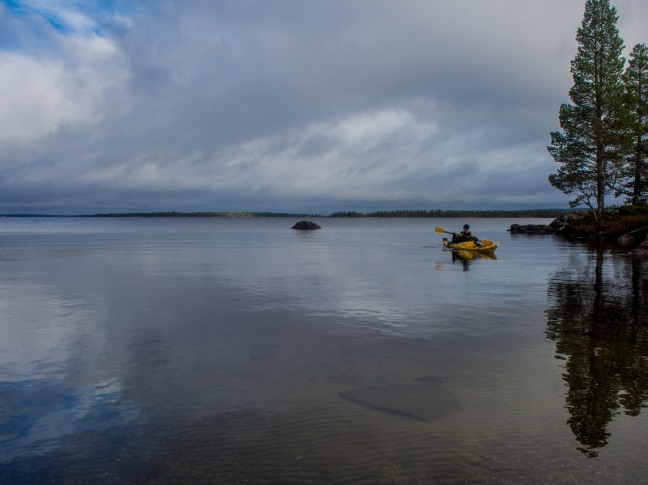 Kayaking on a calm lake Inari