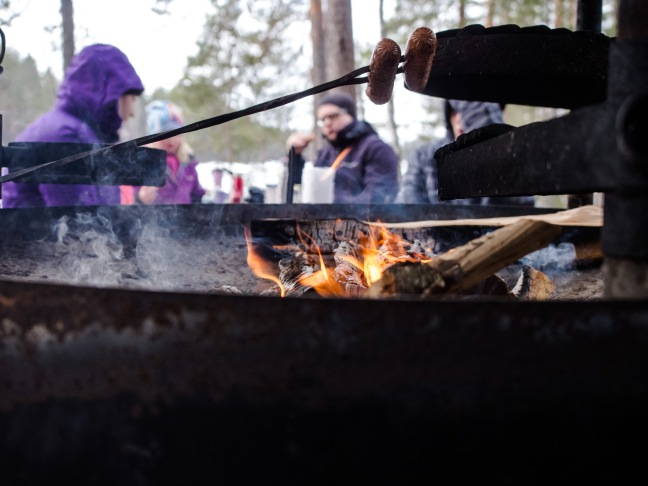 Grilling sausages at Isojärvi National Park